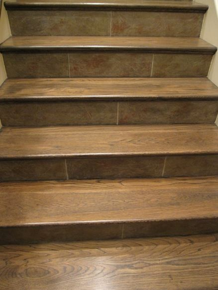 Use entryway tile on stair risers to give some continuity - Stairs with tile and wood ...