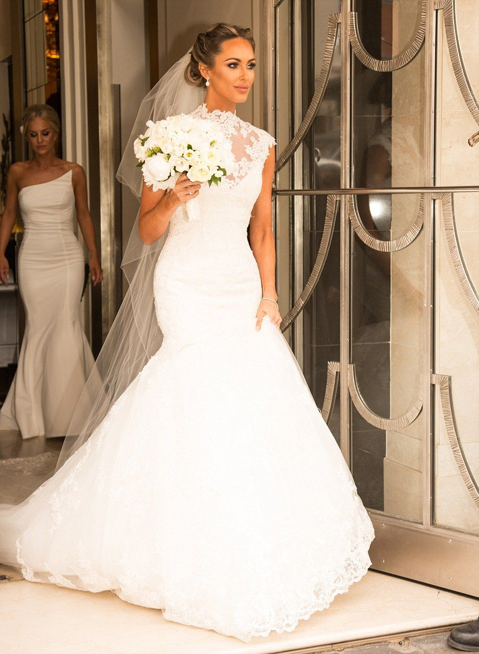 fishtail wedding dress Elegant Wearing an ivory fishtail dress with a high necked lace detail Miss