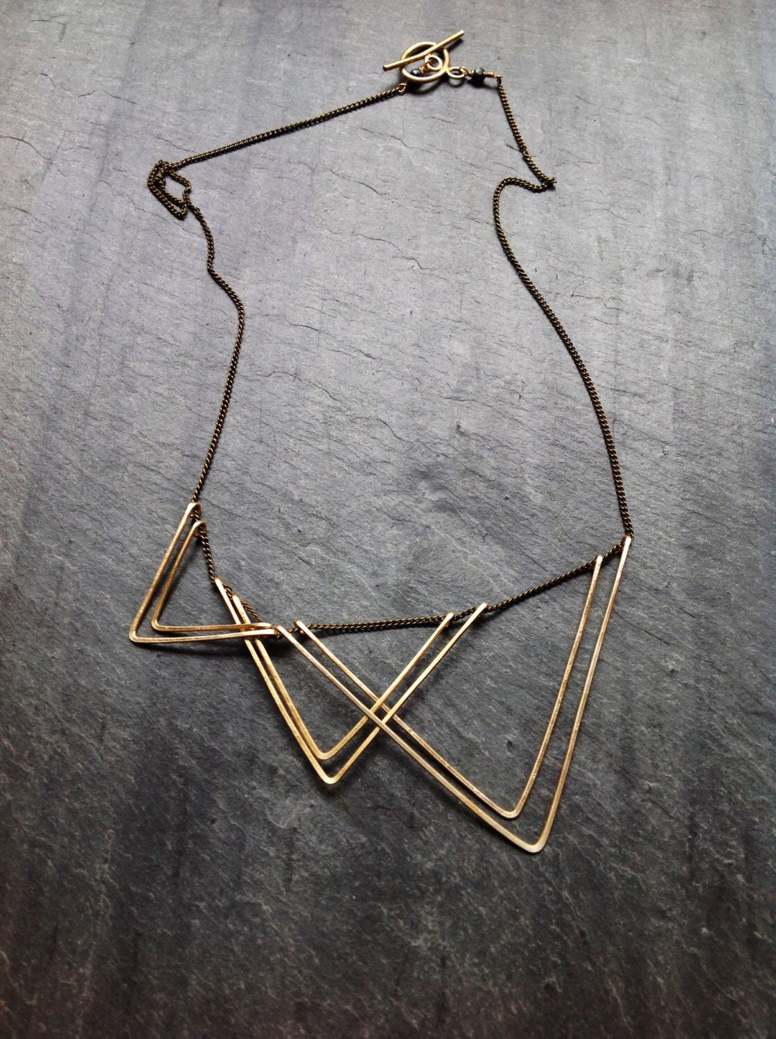Gold Geometric Sails Necklace-By Loop Jewelry-14K Gold-fill Geometric-Sterling Silver Geometric-Portland Jewelry-Hammered Jewelry-Triangle by LoopHandmadeJewelry on Etsy https://www.etsy.com/listing/190046771/gold-geometric-sails-necklace-by-loop