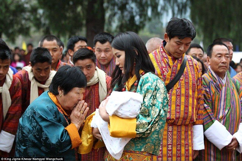 Queen Jetsun Pema meeting some of her subjects with the baby Prince
