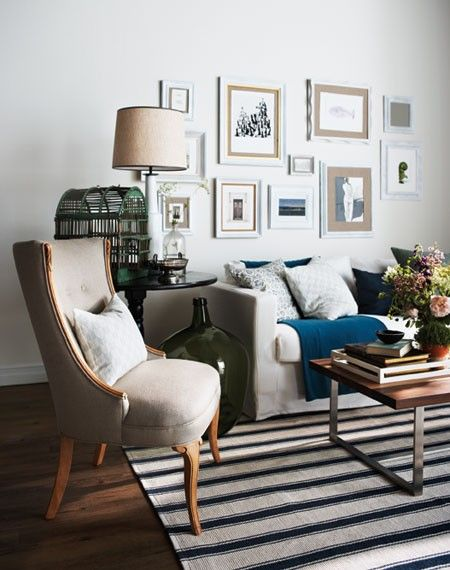 The coffee table, chair, gallery wall, side table, rug...lots of good stuff going on here