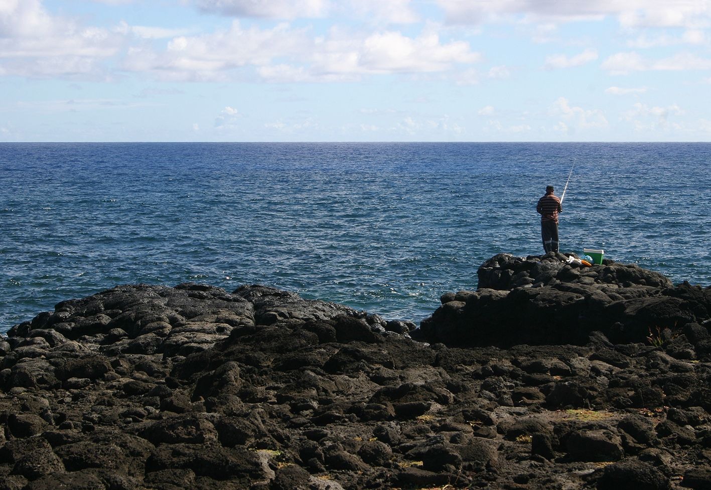 Rapa Nui / Easter Island / Isla de Pascua. Man fishing on the northeast coast. Photo: Mike Seager Thomas, UCL Rapa Nui Landscapes of Construction Project. You are welcome to use/ circulate the photo but please credit it to the project