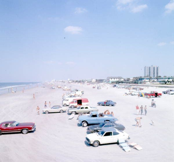 View Of Cars Parked On The Beach