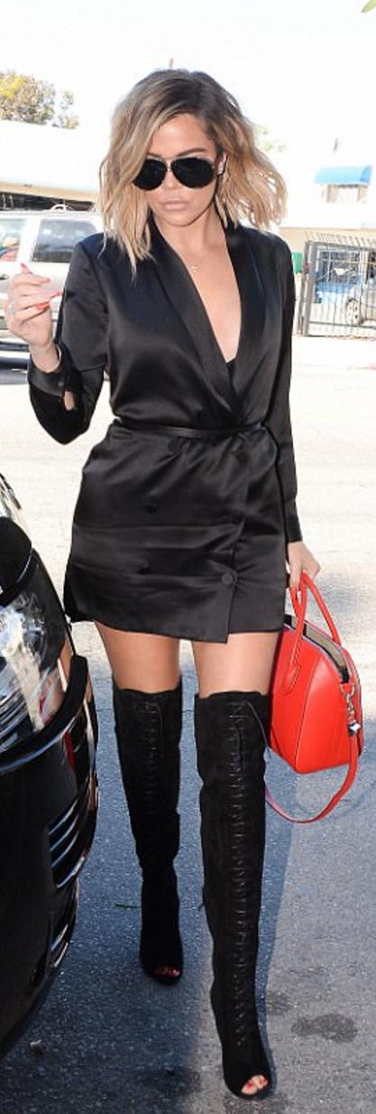 5ecd3dfa60733 Who made Khloe Kardashian's aviator sunglasses, black suede lace up boots,  and red handbag?