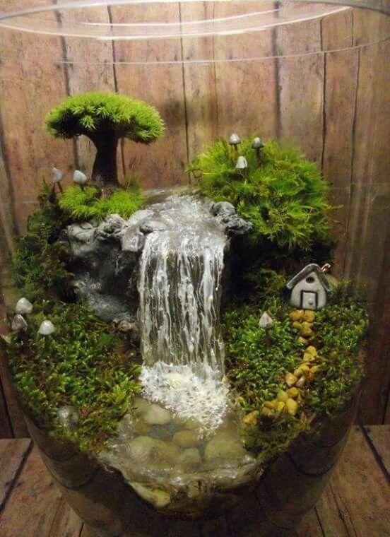 Mini jard n con cascada fuentes pinterest cascadas y for Antorchas para jardin caseras