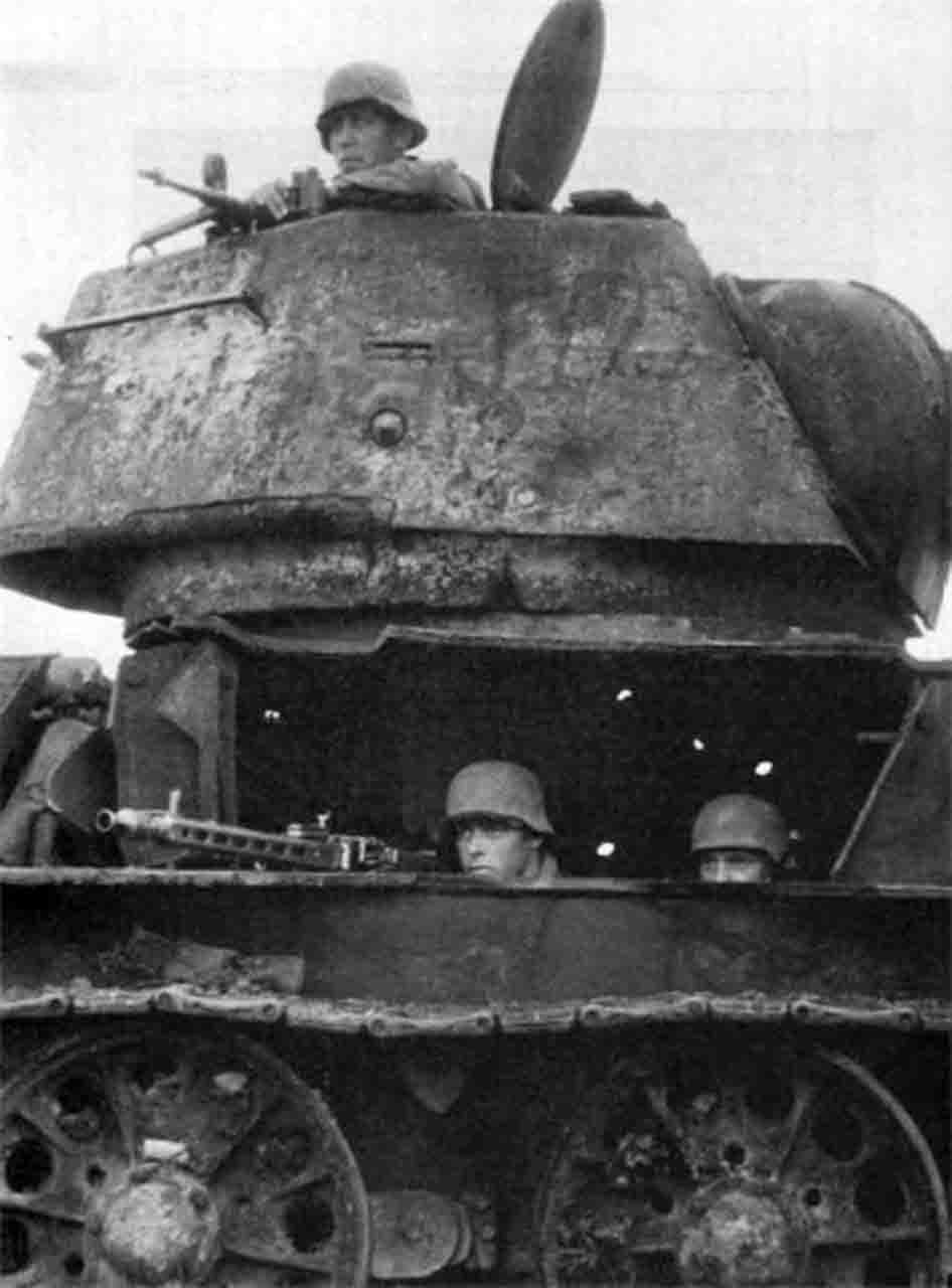 A German machine gunner crew camped out in a destroyed Soviet T-34 tank. Stalingrad