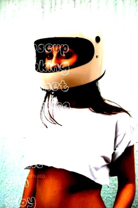 helmet by JohanJK Closeup of a girl in a motorcycle helmet looking at the cameraGirl in helmet by JohanJK Closeup of a girl in a motorcycle helmet looking at the camera S...