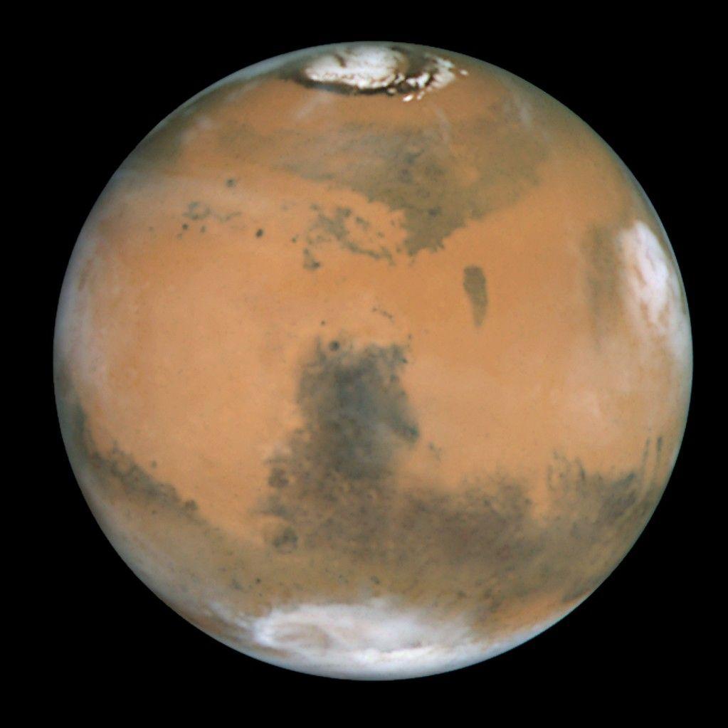 True-color view of Mars seen through NASA's Hubble Space Telescope in 1999  Coffeeoath.com