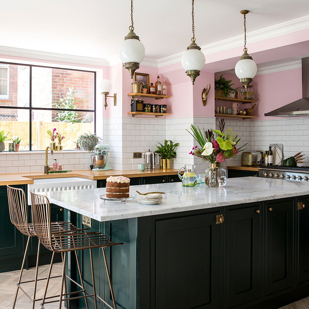 Basement kitchen makeover with emerald green units, marble