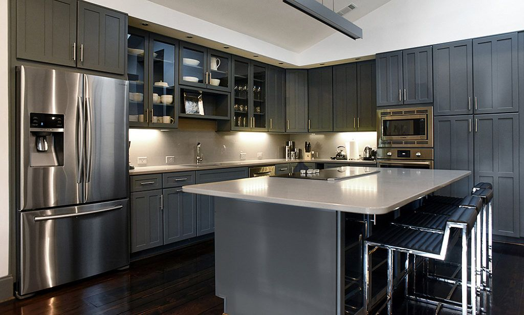 Modern Monochromatic Home The Open Concept Layout Of This Home Is Enhanced By The Monochromat Modern Grey Kitchen Modern Kitchen Design Blue Kitchen Interior