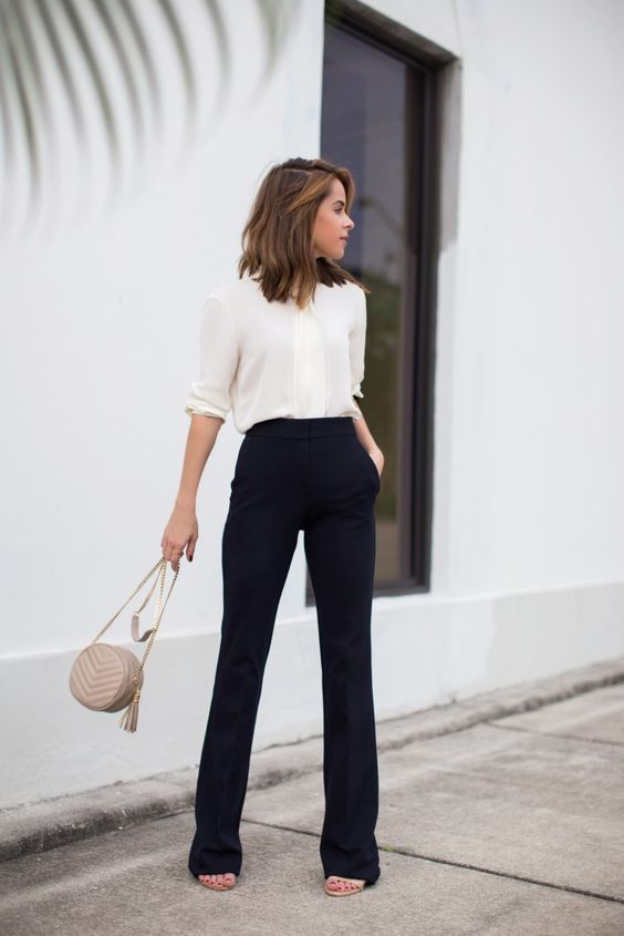 8727be319d Mid sleeve length mesh off white button up blouse with casual black wide  leg trousers. And taupe bag match to match