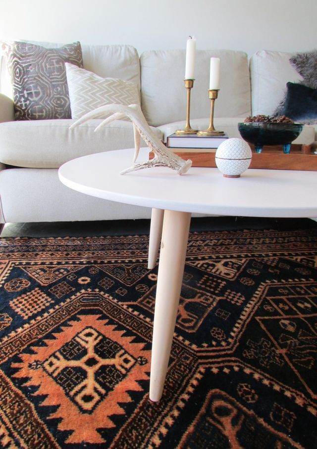 Living room coffee tables in small spaces wear many hats. They function as drink perches, game tables, casual dining tables, craft tables, etc. and our coffee table is no exception. Our new small(er)