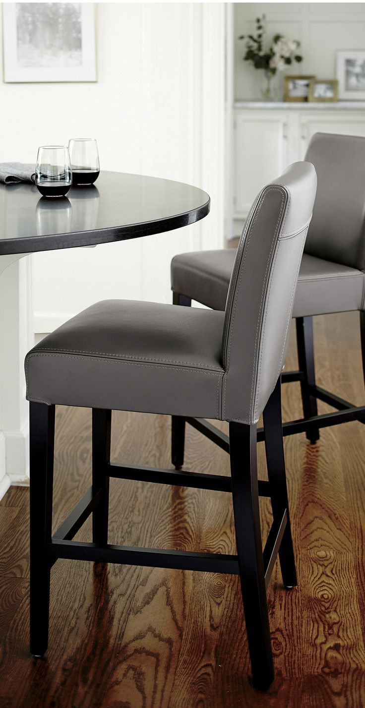 Classic Parsons-style design is echoed in our Lowe leather bar stool, upholstered in soft, pebble-textured bicast leather in a dusky smoke hue. Stylish and contemporary stool scaled especially for bars offers a comfortable, roomy seat and long, lean profile and has been tested for use in commercial spaces such as offices, restaurants and hotels.