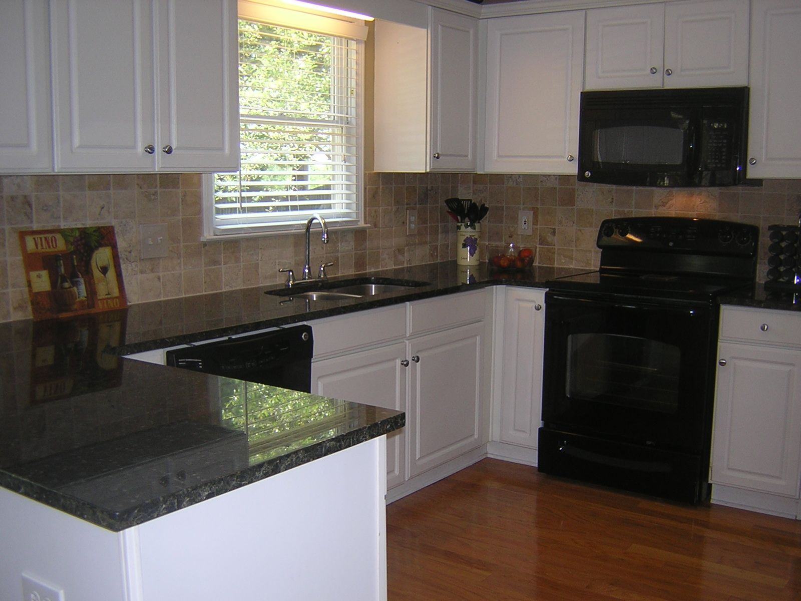 White Kitchen Update Replaced White Laminate Countertops With Verde Butterfly Granite And Added A Travertine