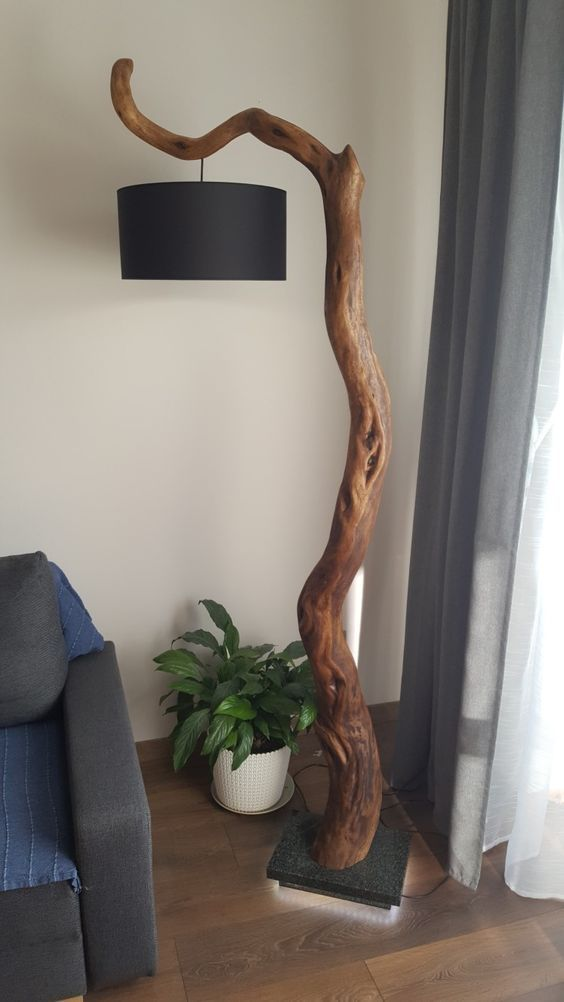 Photo of A standing living room lamp made of driftwood wood
