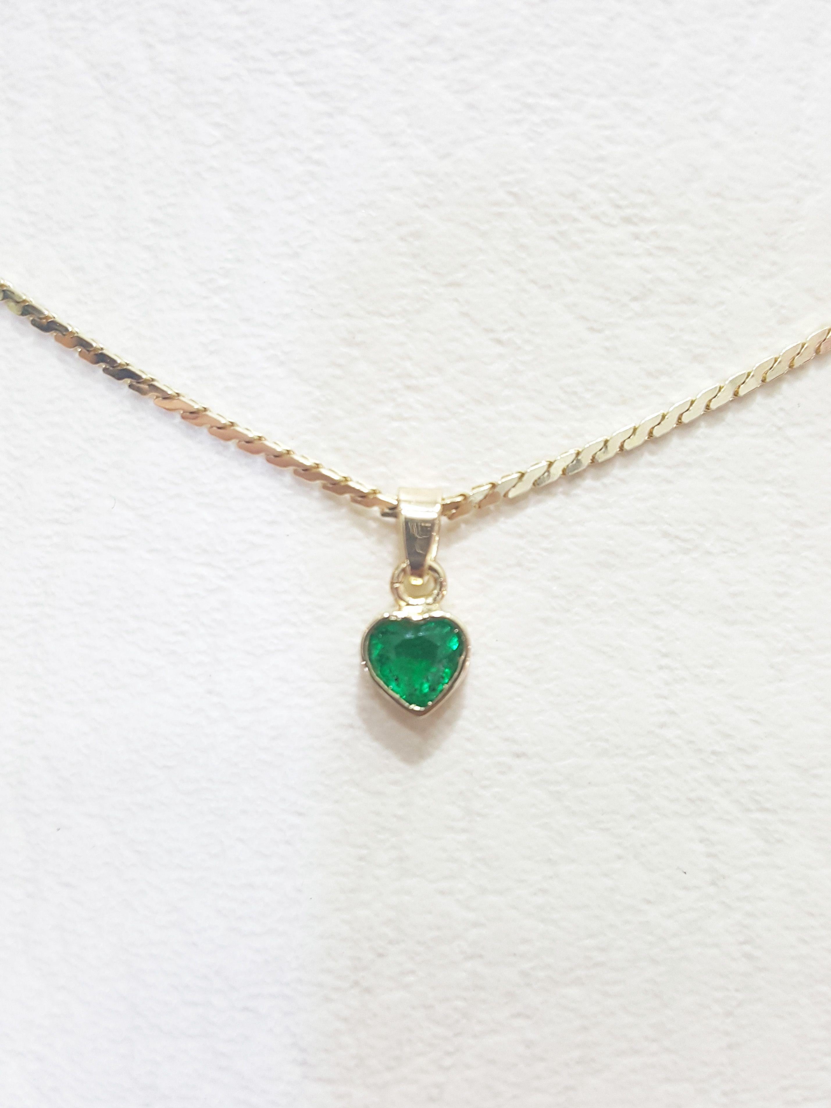 1fc6e5cf1409 cadena y dije con esmeralda en oro de 18K