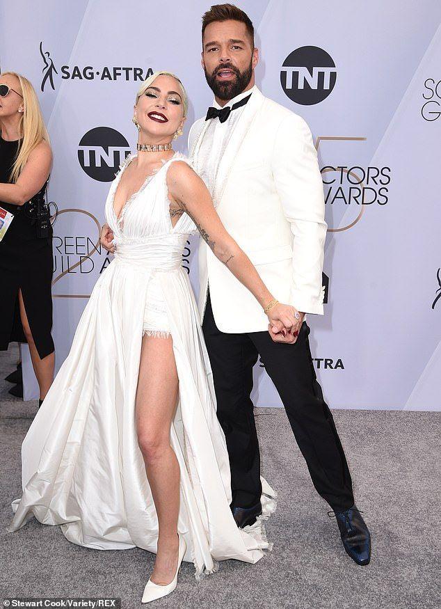 Lady Gaga walks SAG red carpet in Dior gown that d