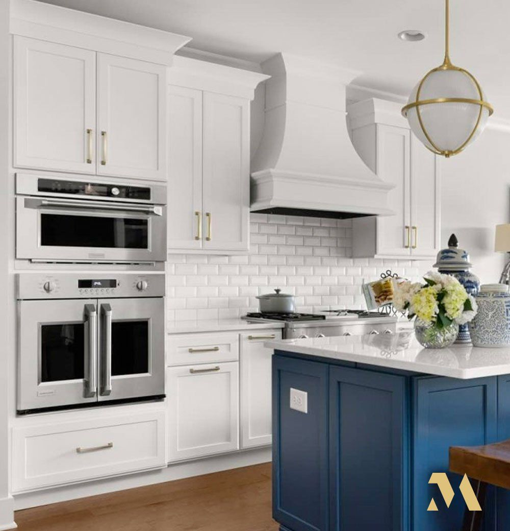 Love The Striking Nautical Blue Crystal Cabinets Island In This White Kitchen With Monogram In 2020 Professional Kitchen Appliances Monogram Appliances Cabinet Island