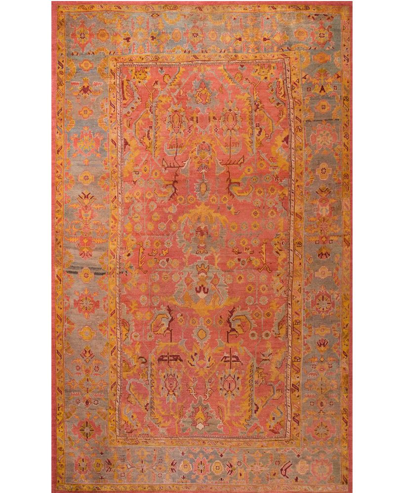 An Antique Salmon And Blue Rug Carpet Available Through