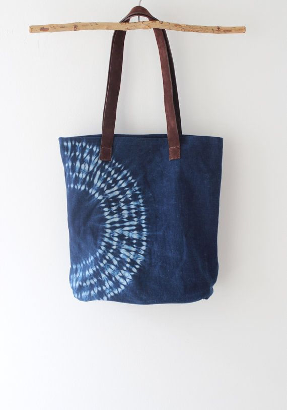 You are getting a unique handbag, since no two bags are alike. A great handbag to use like going-out bag, work bag, casual bag and more. In this handbag we use a Japanese Shibori technique, then dyed in natural indigo to make this pattern. All the process is handmade. This handbag is made of 100% cotton denim, dyed in natural indigo obtained from Añil plant. With brown leather handles, a dark blue cotton lining and an always very useful inner pocket. Approx., measurements: Height: 14 1/2 in…