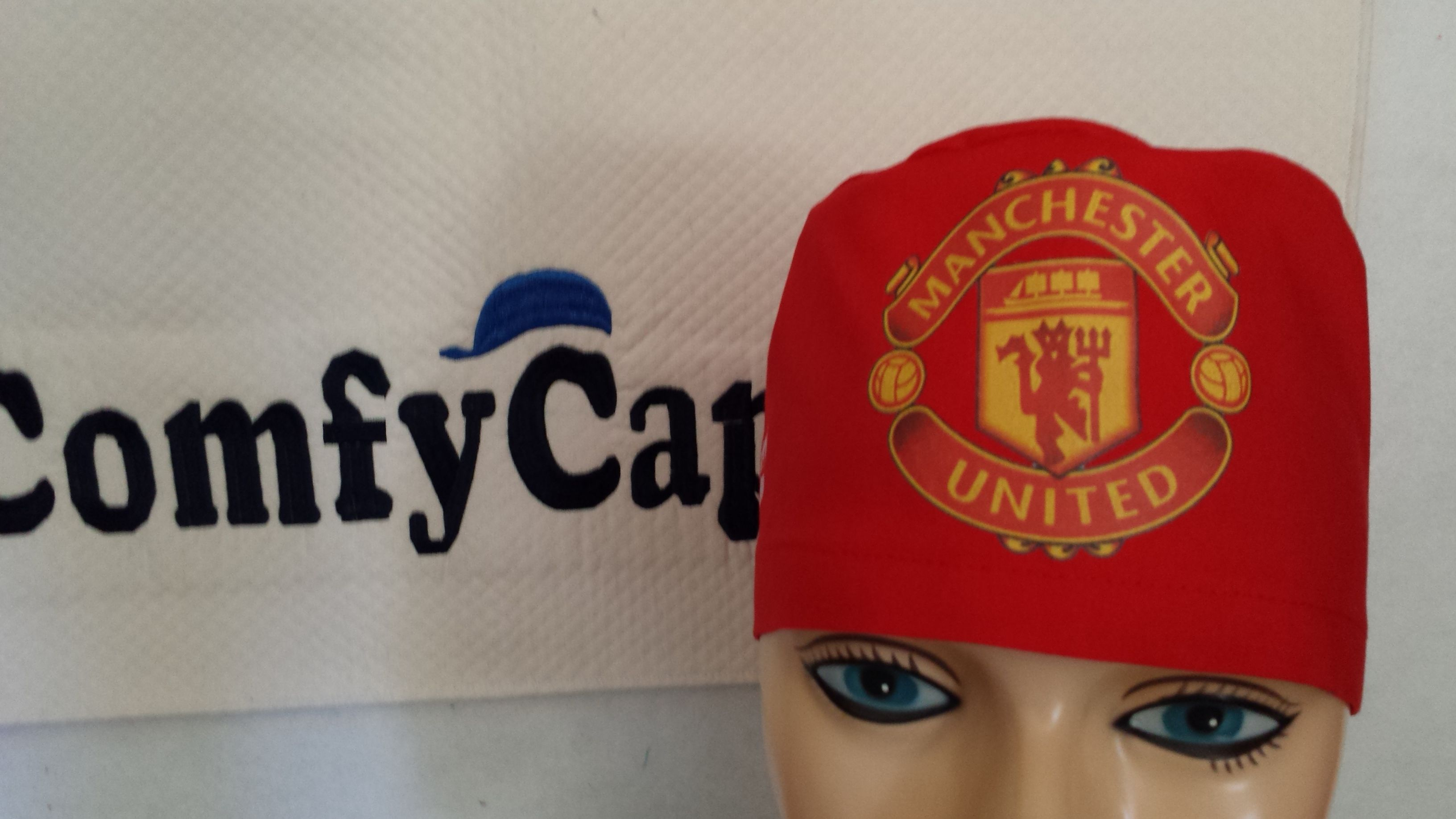 05f81be2 Custom imprinted male scrub cap with Manchester United logo on the front.