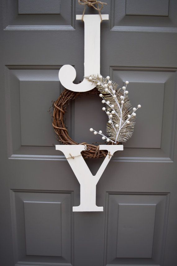 joy christmas wreath by theclassygoose i might modify this by spray painting or using a white or gold wreath instead attaching the j y with eye hooks