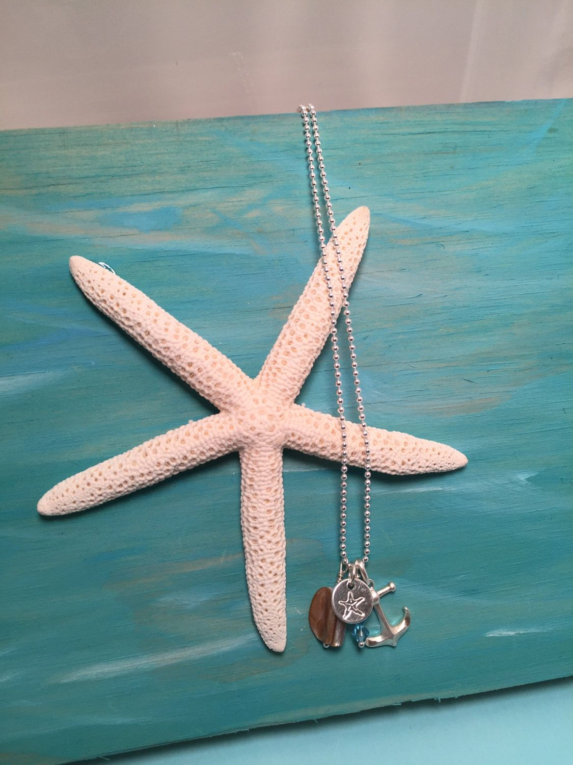 A personal favorite from my Etsy shop https://www.etsy.com/listing/256425654/nautical-necklace-anchor-necklace