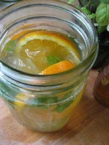 New Nostalgia – Iced Tangerine Mint Green TeaIced Tangerine Mint Green Tea ~4 organic green tea bags ~1/2 tangerine, sliced ~fresh mint leaves ~honey to taste ~water, just boiling ~ice
