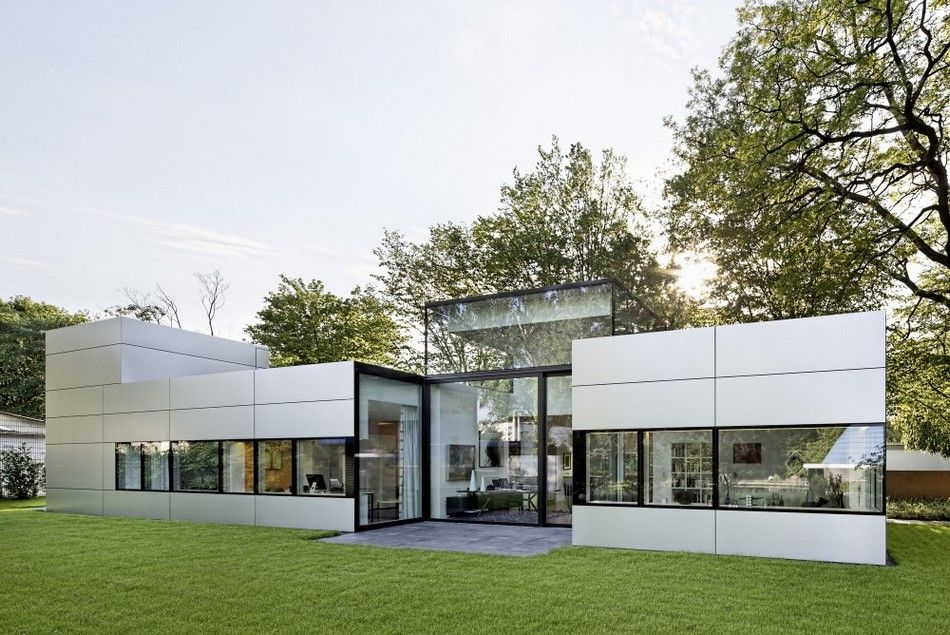 modern single story cubical house with a metal facade in cologne
