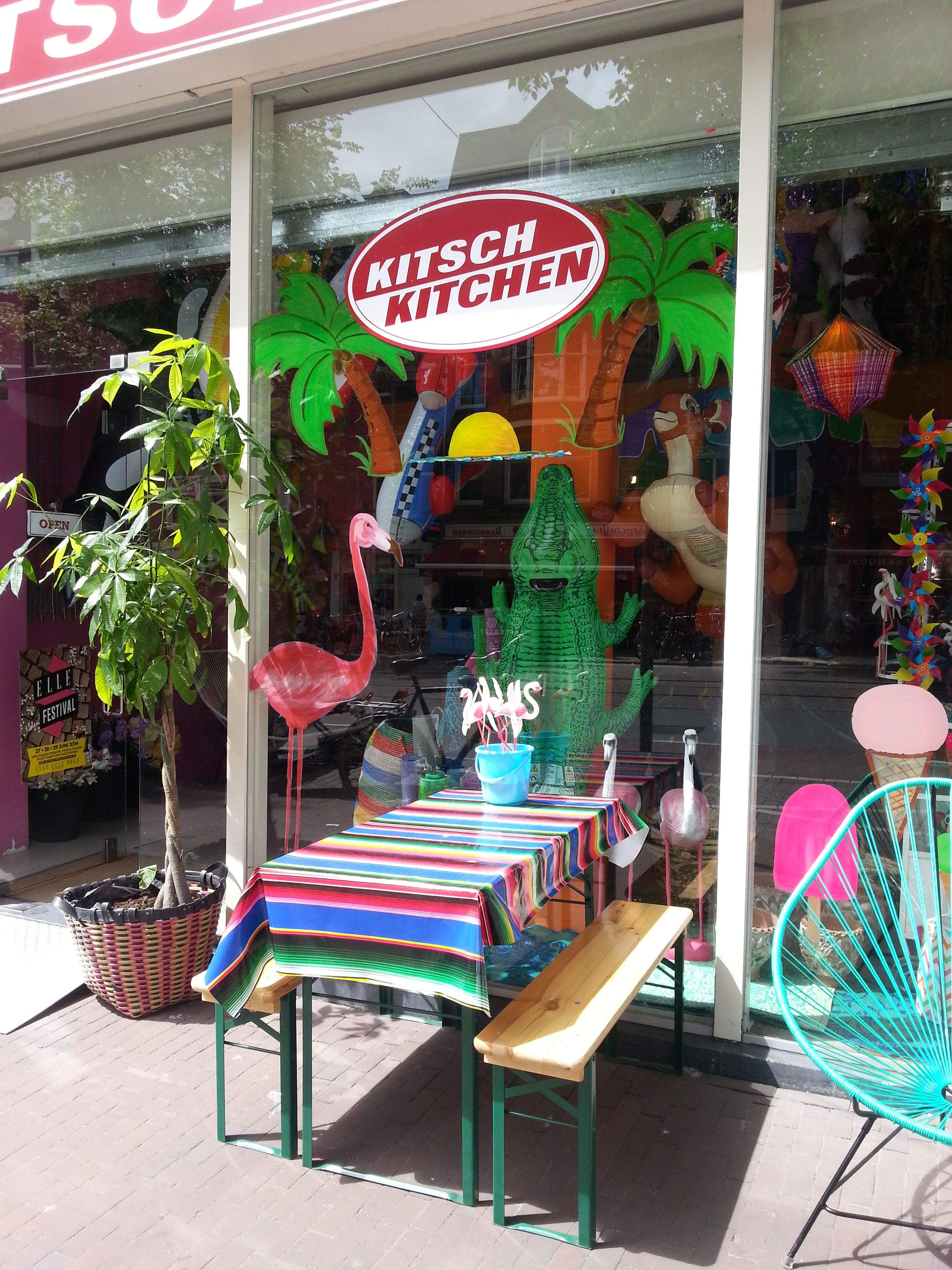 Summer in #Amsterdam! Our #pink #flamingo window draws a lot of attention. Buy yourself a #flamingo in our webshop: www.kitschkitchen...