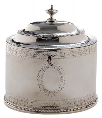 Caddy London, 1783, oval with bead border and bright-cut engraved decoration, lock and working key, dome top with urn finial, marks for Hester Bateman, .925 fin