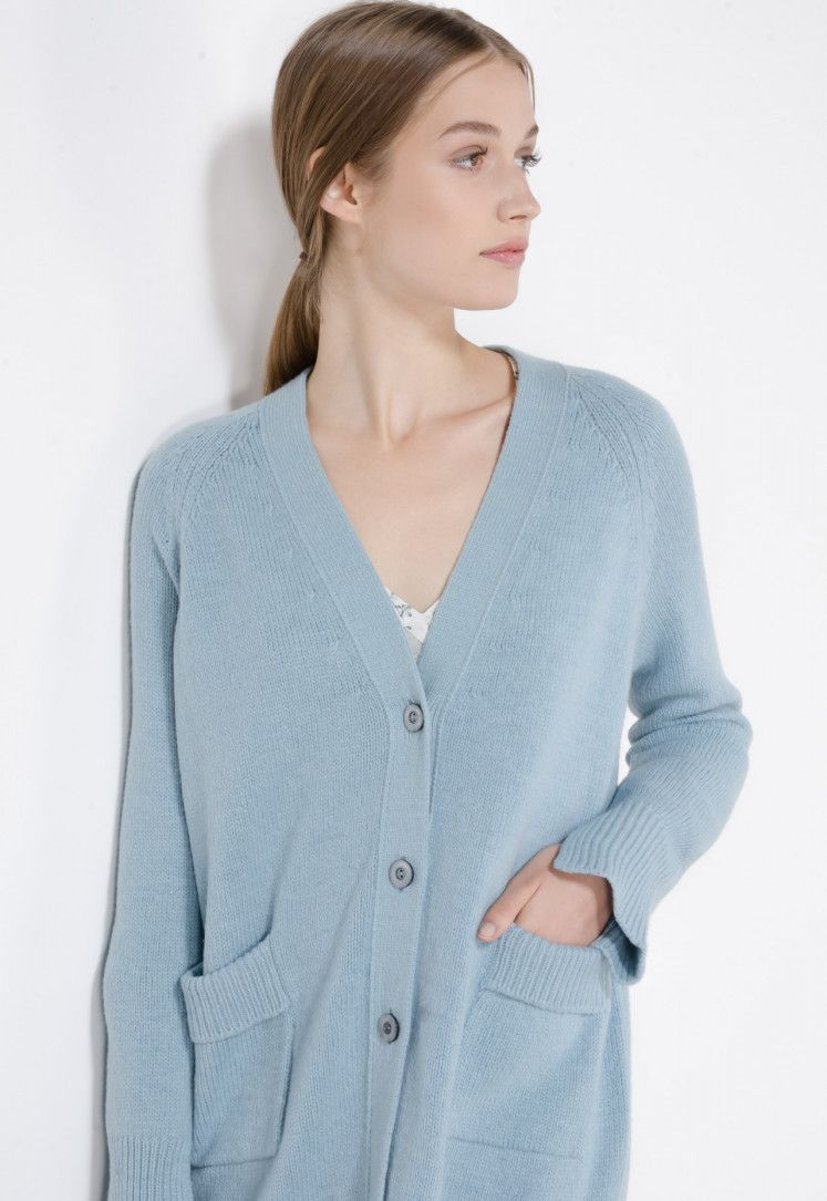 eb892d1976b0 Plain knit wool cardigan. V-neck and open at the front. The loose, soft  design is straight at the mid-thigh, with practical side vents.