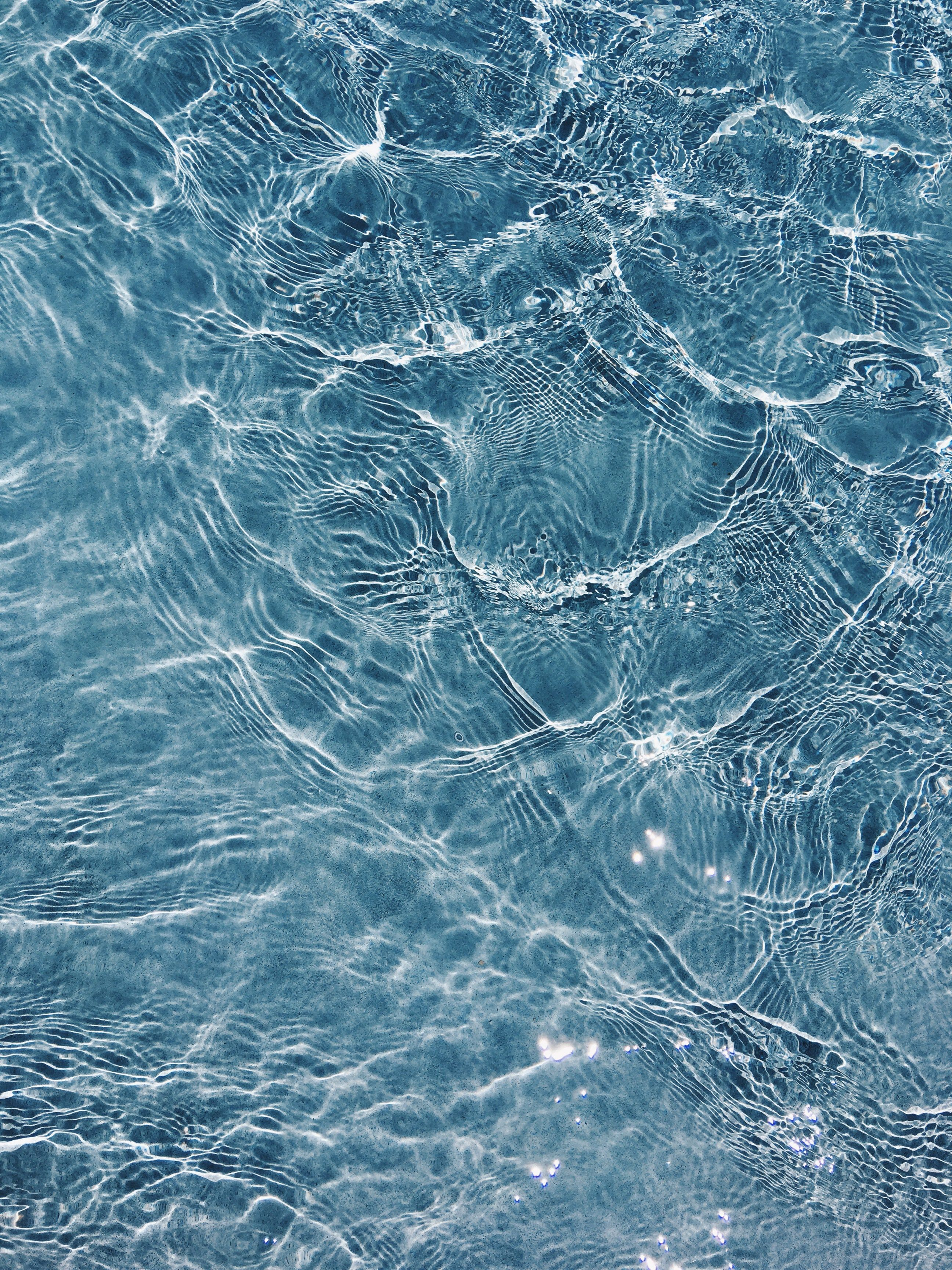 A Reflection And Ripples In A Swimming Pool