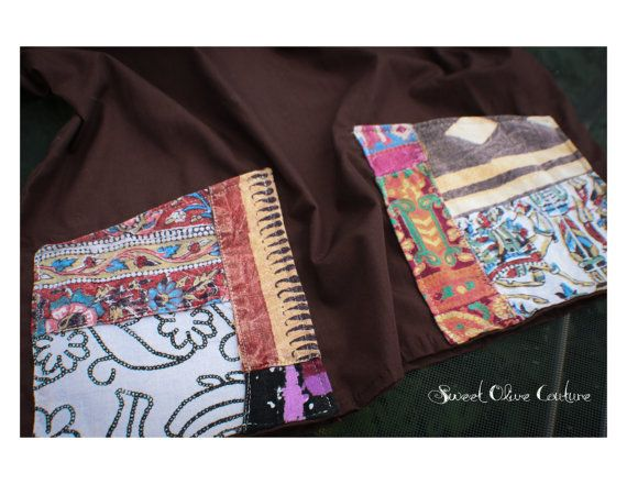 """https://www.etsy.com/listing/202923164/unisex-medical-scrubs-top-one-of-a-kind?ref=related-6   Unisex, L, chocolate brown scrub top with two waist pockets. Pockets are detailed with unique, durable linen print material. Longer length to tuck in or wear it out. The approximate length for size large is 28""""."""