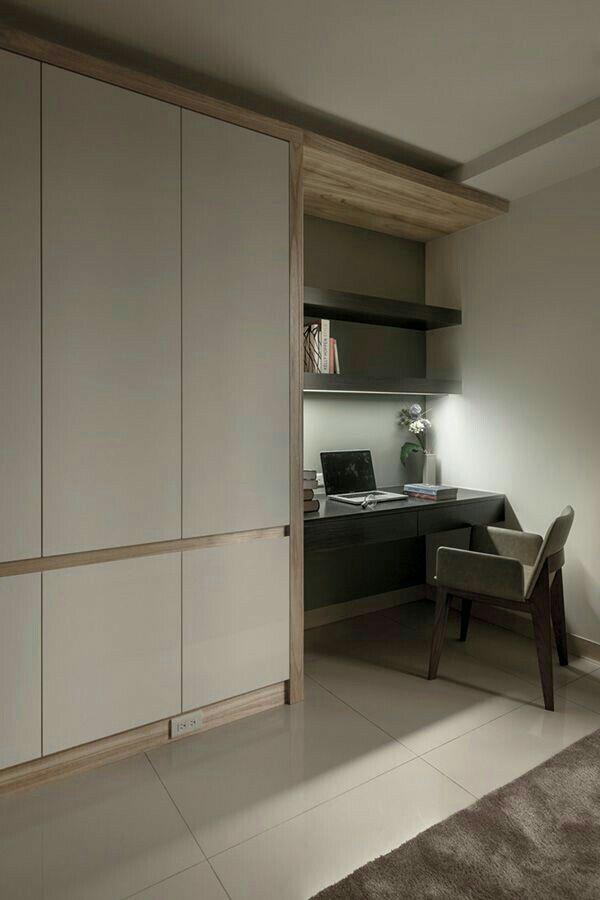 Colour behind desk area. Modern closet doors.