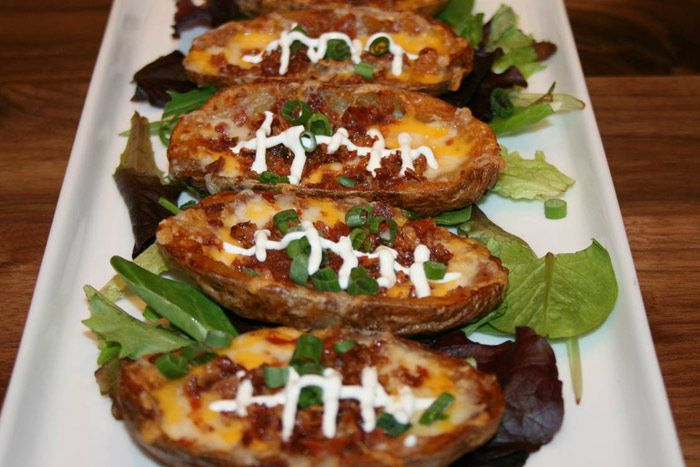 """Tony C's Sports Bar and Grill, a restaurant with two Boston-area locations, is serving up football-inspired fare this season. Clever menu items include a dish called """"Pig Skins,"""" which is actually potato skins with two types of cheese, bacon, scallions, and sour cream drizzled to reflect the stitches on a football.  Photo: Courtesy of Tony C's"""