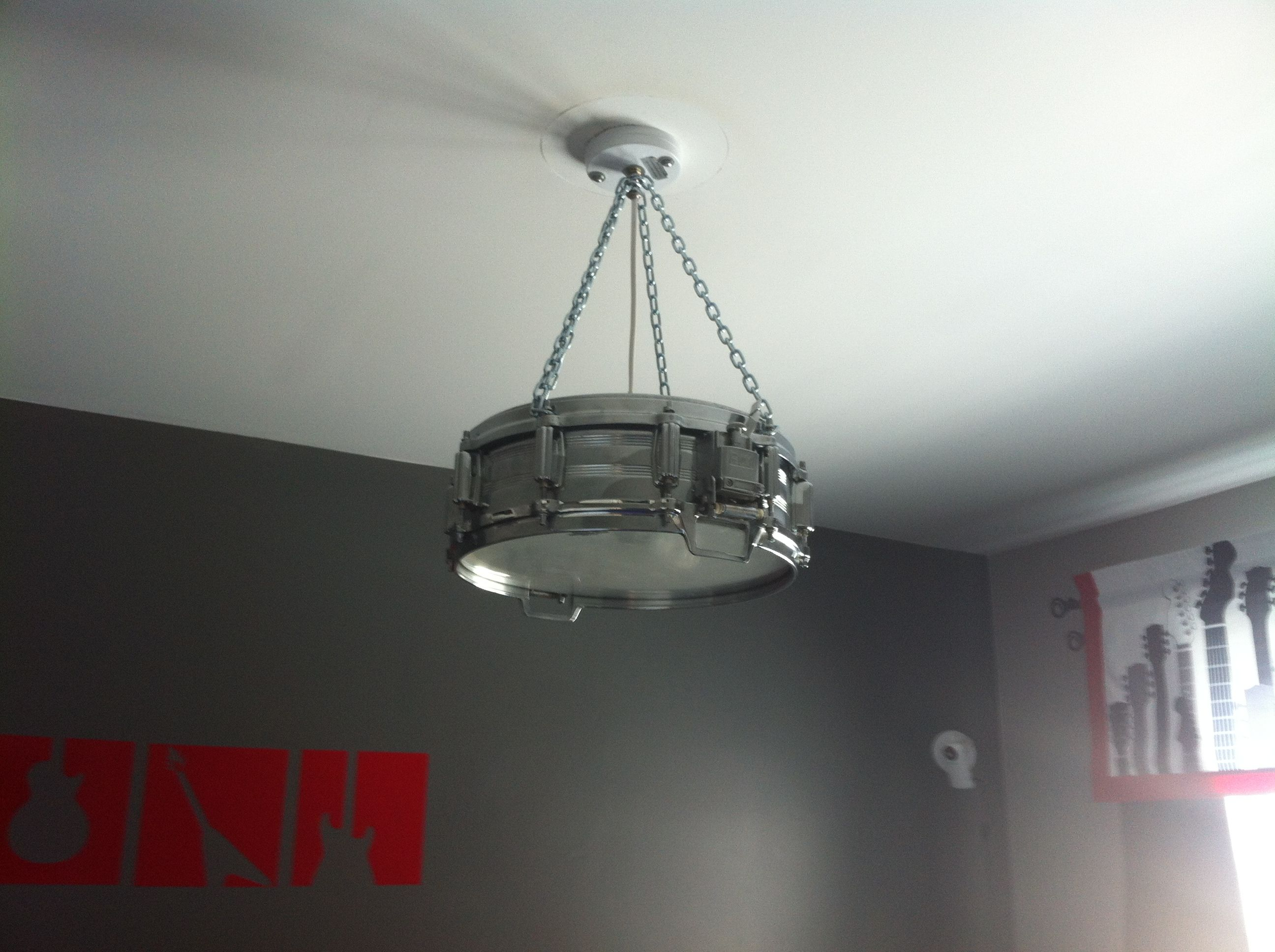 our rockstar 39 s nursery drum light fixture my dad made from his snare drum that he played for. Black Bedroom Furniture Sets. Home Design Ideas