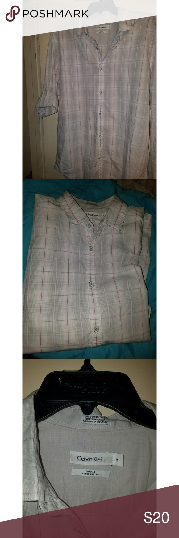 Calvin Klein button down shirt Good condition. Buttons are fading as shown. Calvin Klein Tops Button Down Shirts