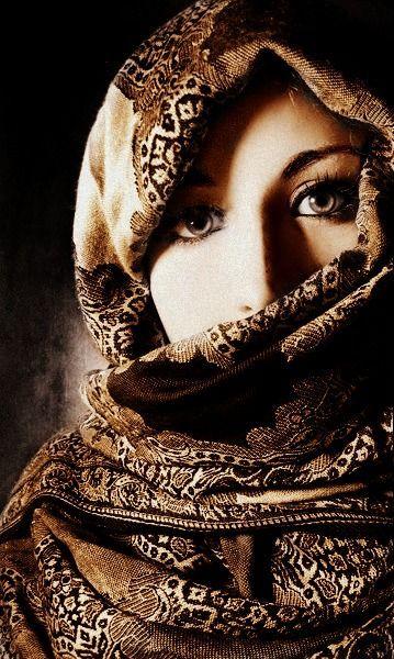 shrouded woman
