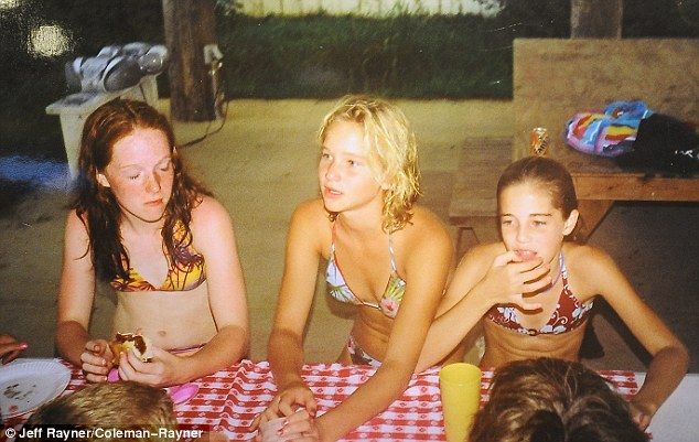 Bathing beauties: Jen entertains friends at a barbecue at her family home in Louisville...Jennifer Lawrence