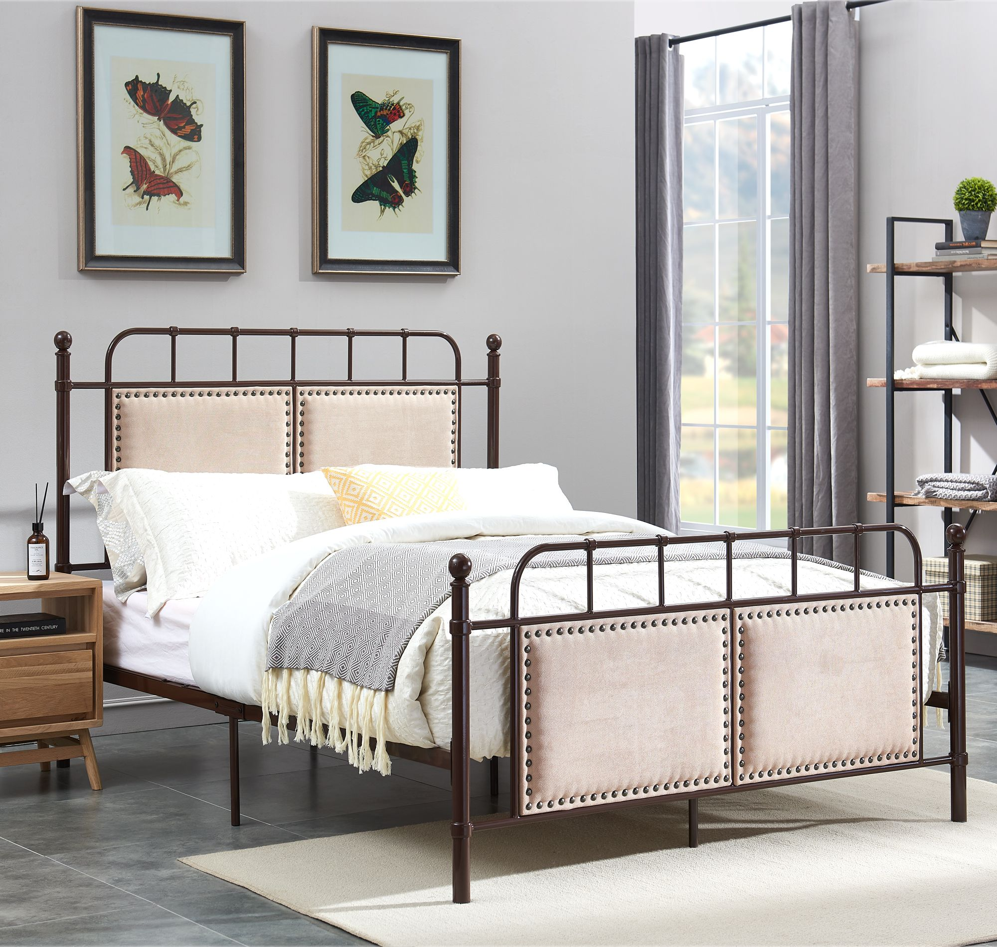 Both headboard and footboard of this metal bed are