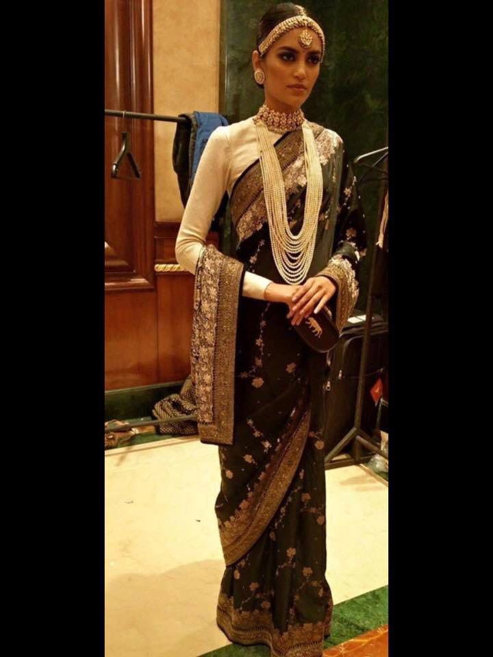 This black saree designed by Sabyasachi with