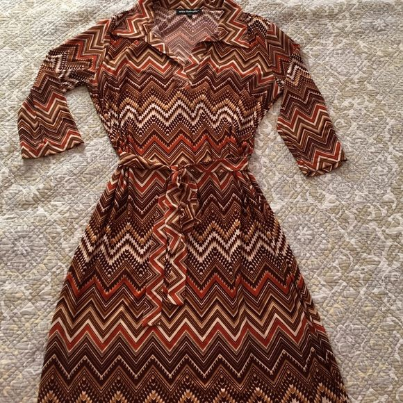 """Chevron print shirt dress Stretch jersey pull-on shirt dress. Polyester spandex. Three-quarter sleeves. Self-tie. Beautiful tan, brown and orange colors. 42"""" from shoulder to hem. Mlle Gabrielle Dresses"""