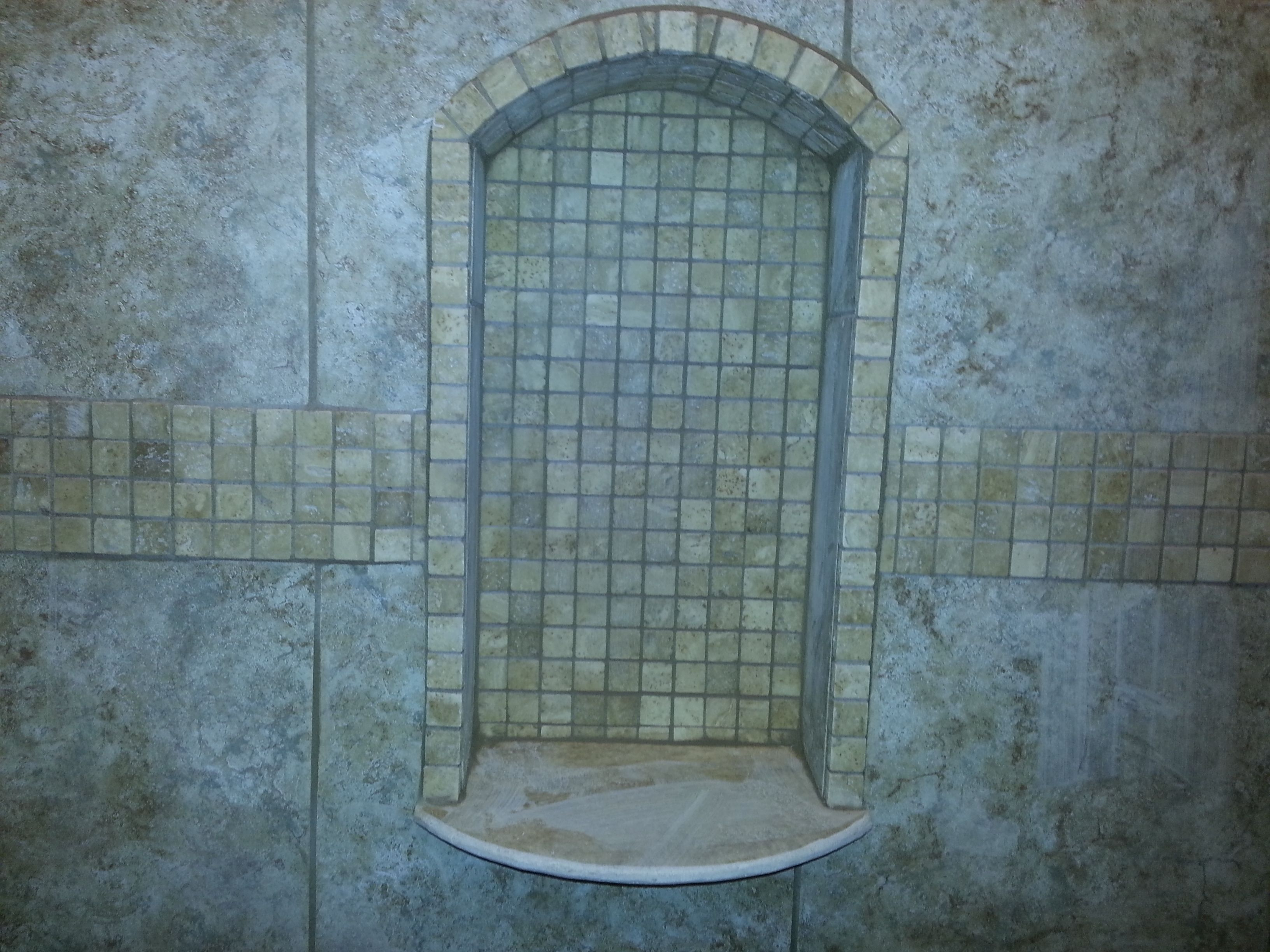 Shower niche with stone shelf curved and shaped with an eyebrow arch ...