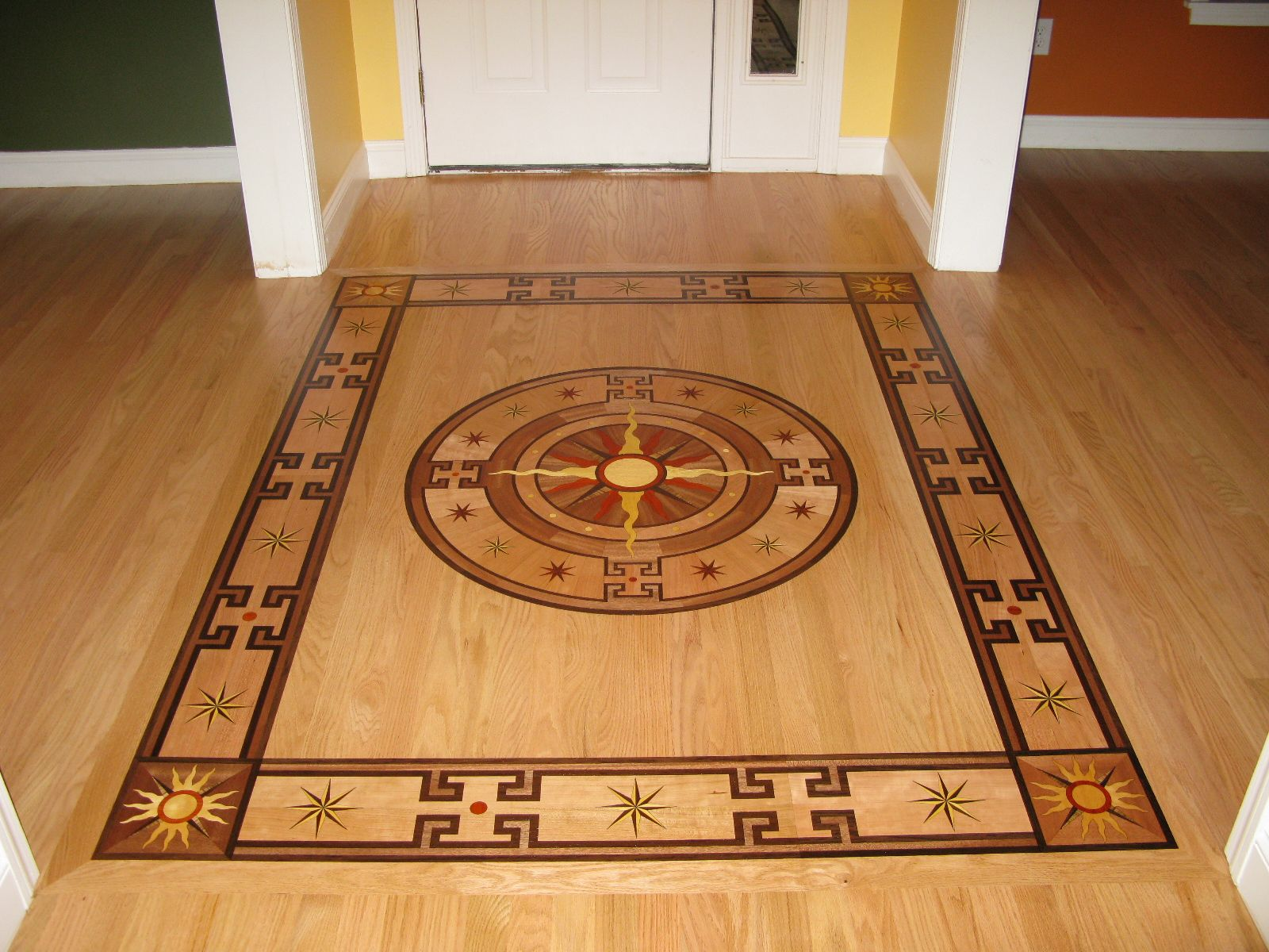 Oshkosh designs del sol wood border corner medallion for Hardwood floor borders ideas
