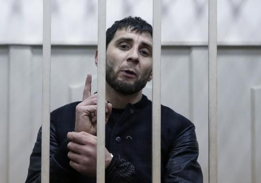 """Scapegoat or killer? """"Zaur Dadayev, [one of two Chechens] charged with involvement in the murder of Russian opposition figure Boris Nemtsov, speaks inside a defendants' cage in Moscow, [today] Mar. 8, 2015.  REUTERS-Tatyana Makeyeva"""""""