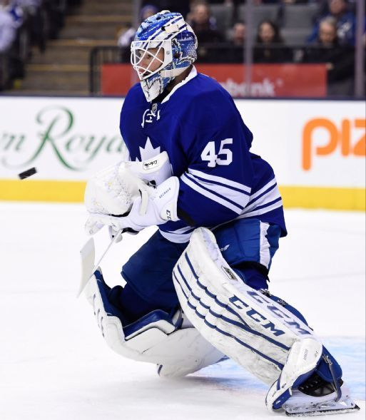 Toronto Maple Leafs goalie Jonathan Bernier makes a save against the St. Louis Blues during the first period of an NHL hockey game Saturday, March 7, 2015, in Toronto. (AP Photo/The Canadian Press, Frank Gunn)