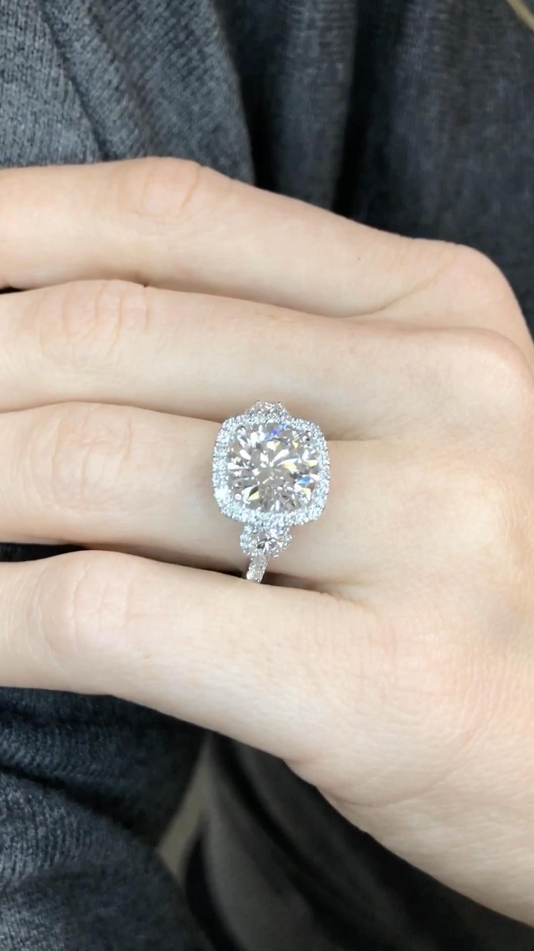 A unique engagement ring custom designed for a one of a kind love. Features a brilliant round cut diamond adorned with a delicate halo style and side stones, handmade in 18 karat white gold by Ascot Diamonds.    #engagementringsideas #engagementringsunique #ascotdiamonds #diamondengagementrings