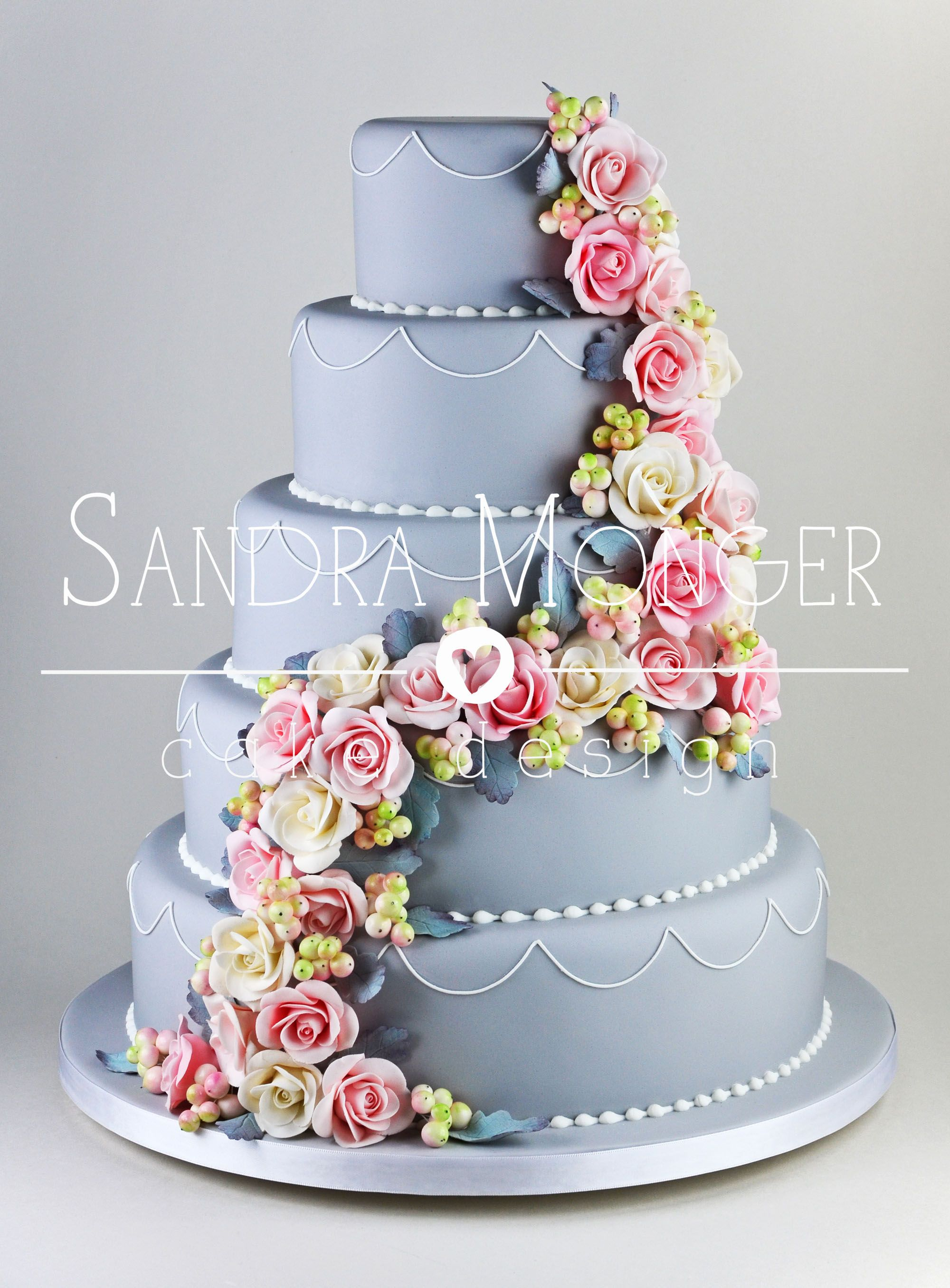 Traditional wedding decor blue and white  Pink and white rose cascade with dusty miller leaves and snowberries