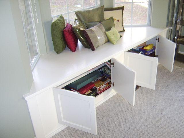 Under Window Seating storage, bay window with throw pillows corner bench under window